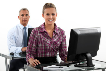 Business people working at computers