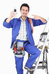 plumber showing cell phone