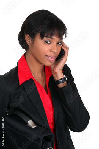 Businesswoman speaking to client over the telephone