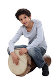 Young boy playing the djembe