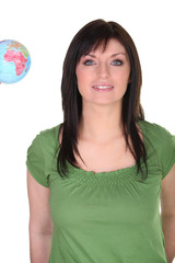 Woman stood with small globe