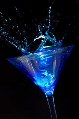 Blue Martini Cocktail with splash on black