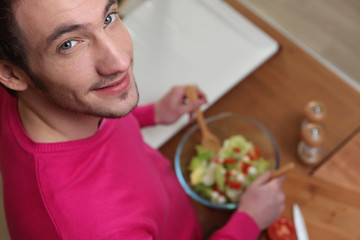 Man preparing healthy salad