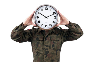 soldier with analog clock over his face. Deadline concept