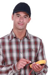 Man taking electrical reading