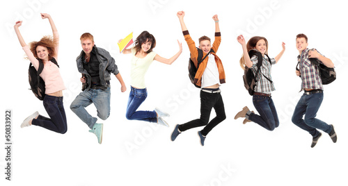 Happy young caucasian people jumping into the air