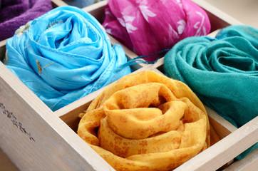 Set of colorful scarves in vintage wooden box