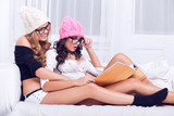 Two sexy girls reading