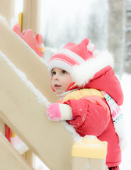 Beautiful happy kid in the red warm clothing