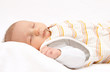 Leinwanddruck Bild - Sleeping baby on back in sleeping bag