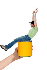 Excited male decorator sitting on paint tin