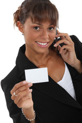 Woman calling number on business-card