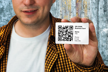 Construction worker with QR code business card