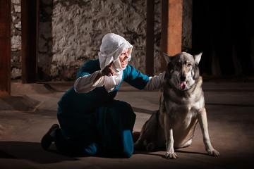 Nun Talking to Dog