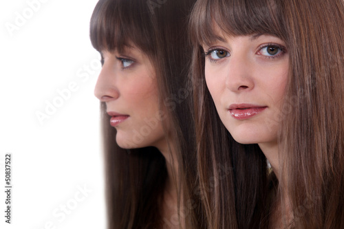 portrait of young woman near mirror