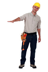 Carpenter gesturing on white background