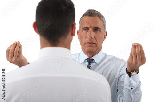 Angry boss talking to employee