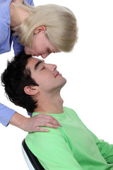 Woman kissing tenderly man on the forehead
