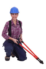 Woman holding bolt cutter