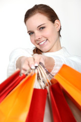 Woman holding lots of shopping bags