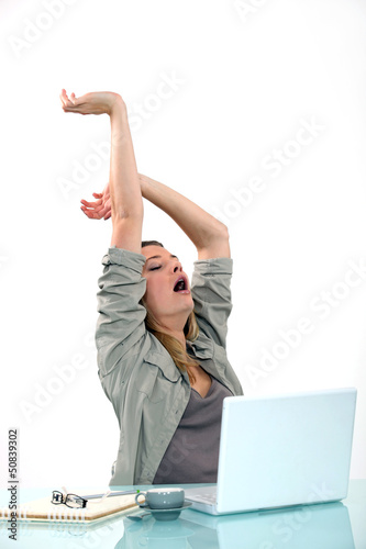 Woman yawning at desk