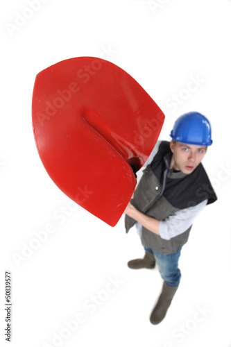 Laborer lifting shovel