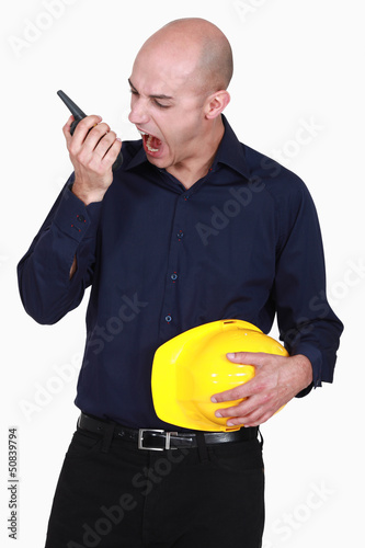 Engineer screaming into a walkie-talkie