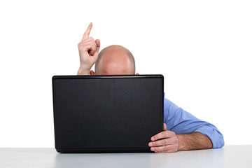 Man with laptop pointing