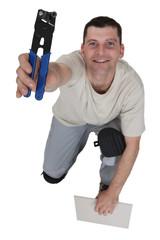 Man preparing to cut tile to size