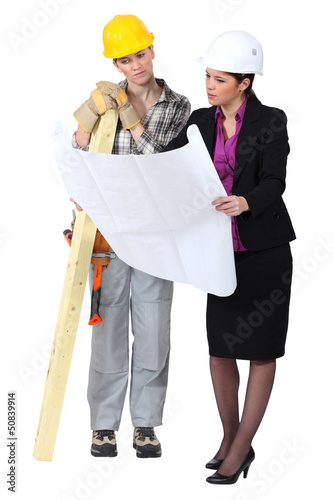 Female architect and carpenter