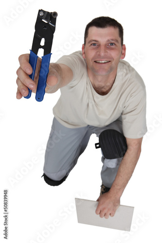 Man preparing to cut tile to size
