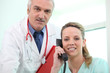 Doctor posing with his assistant