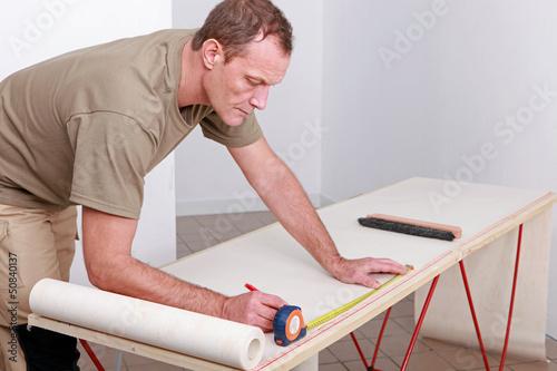 Man measuring wallpaper