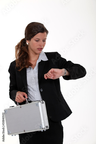 young businesswoman checking her watch