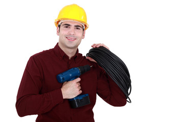 electrician holding drill and cable