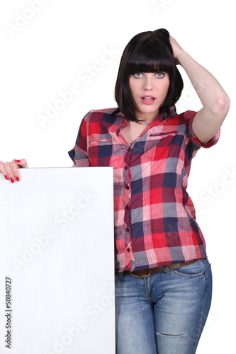 sexy woman holding an empty board