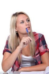 Student with a pen in her mouth