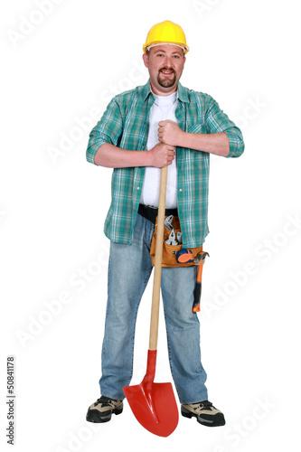 Artisan stood with shovel