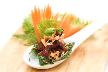 Fried crispy pork with herb