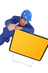 Man with yellow road sign