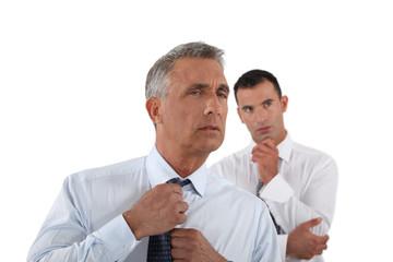Senior businessman adjusting tie before meeting