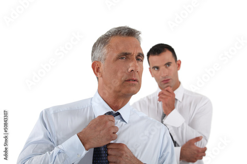 Senior businessman adjusting tie before meeting