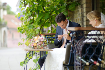 Bride and groom in outdoor cafe
