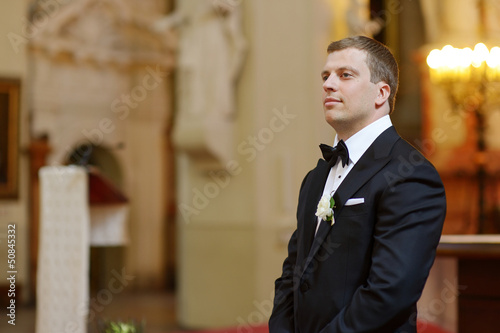 Groom waiting for the bride in church