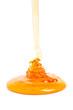 Rinnender Honig auf weißem Hintergrund