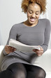 Woman reading new spaper