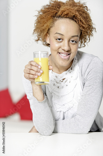 black woman drinking juice