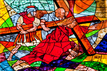 Stained glass showing Jesus falls under the Cross