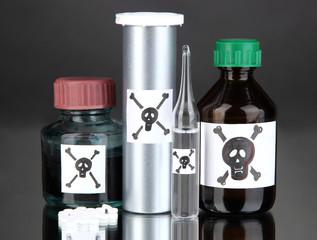 Deadly poison in bottles on black background