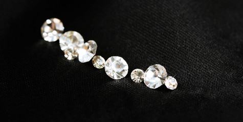 Beautiful shining crystals (diamonds), on black cloth